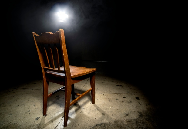 Empty Chair in an Interrogation Room